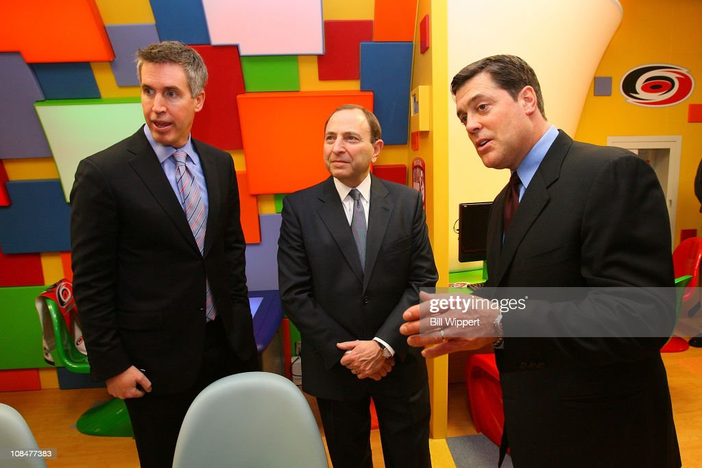 NHL Executive Vice President of Marketing Brian Jennings, NHL Commissioner Gary Bettman and President Companions in Courage Pat LaFontaine talk in the 'Lion's Den' during the Lion's Den 'Champions in Courage' North Carolina Chidren's Hospital Chapel Hill visit as part of 2011 NHL All-Star Weekend on January 28, 2011 in Raleigh, North Carolina.