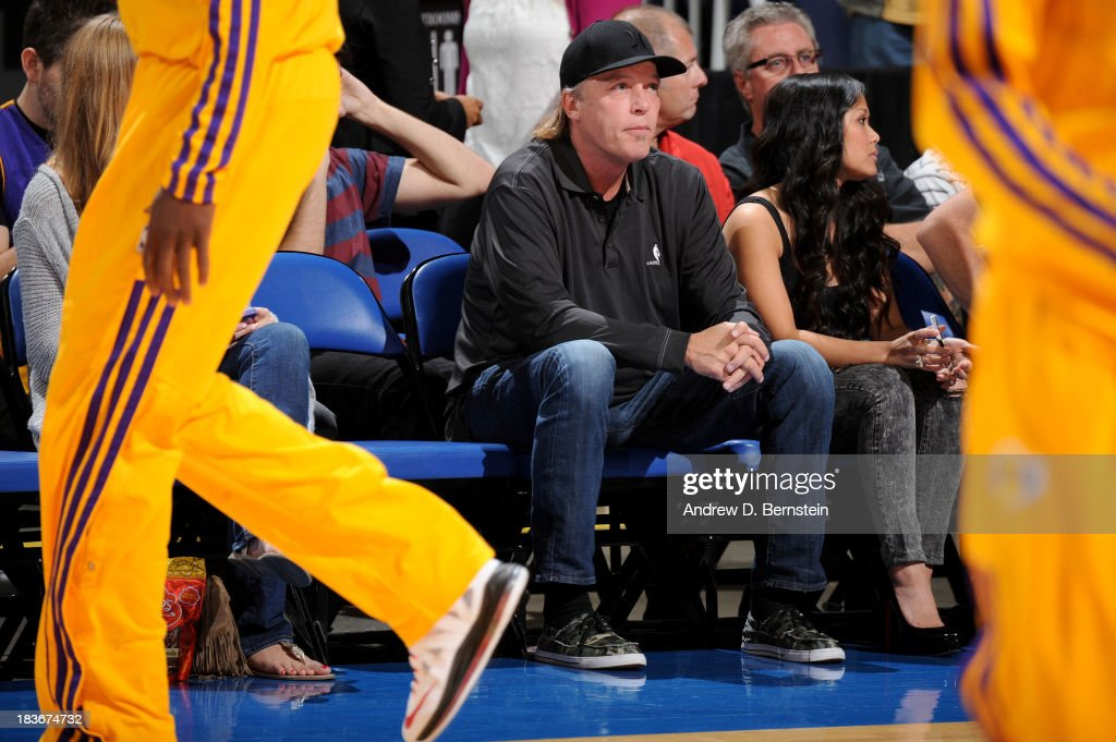 Executive Vice President of Player Personnel <a gi-track='captionPersonalityLinkClicked' href=/galleries/search?phrase=Jim+Buss&family=editorial&specificpeople=5131278 ng-click='$event.stopPropagation()'>Jim Buss</a> of the Los Angeles Lakers watches the game against the Denver Nuggets at Citizens Business Bank Arena on October 8, 2013 in Ontario, California.