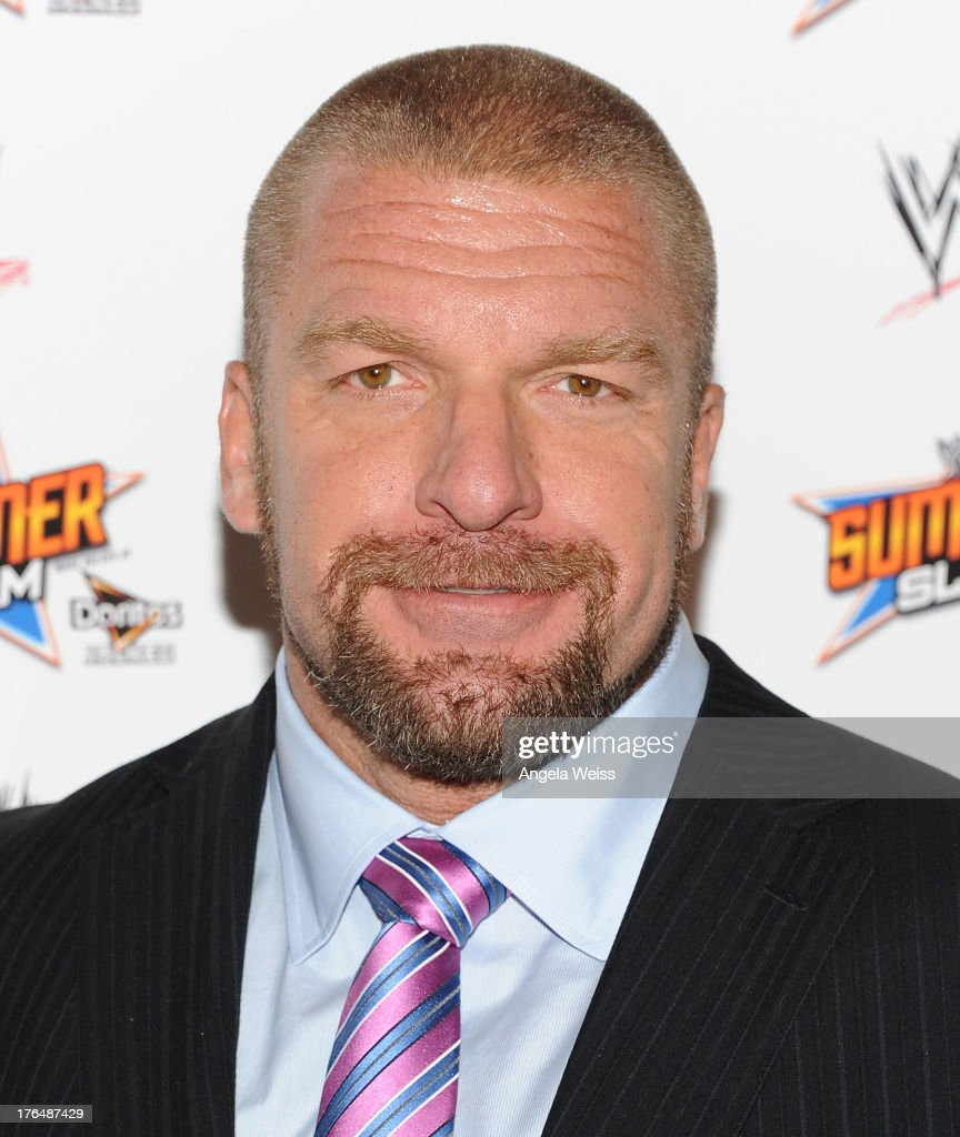 Executive Vice President of Talent and Live Events Paul '<a gi-track='captionPersonalityLinkClicked' href=/galleries/search?phrase=Triple+H&family=editorial&specificpeople=239176 ng-click='$event.stopPropagation()'>Triple H</a>' Levesque attends the WWE SummerSlam press conference at Beverly Hills Hotel on August 13, 2013 in Beverly Hills, California.