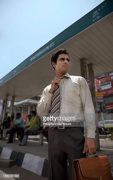 Executive waiting at the bus stop