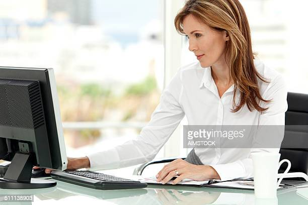 Woman using computer at workplace