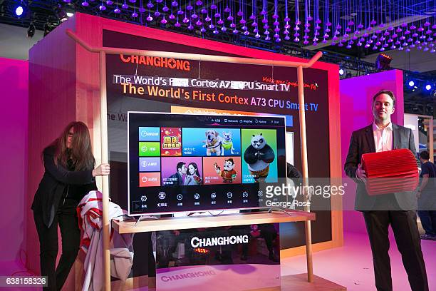 Executives at the Changhong booth introduce a series of new products including a new 8K high definition television during the annual Consumer...