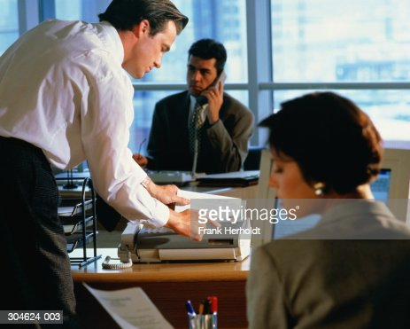 Executives at work in office : Stock Photo