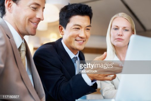 Executives concentrating on a project : Stock Photo