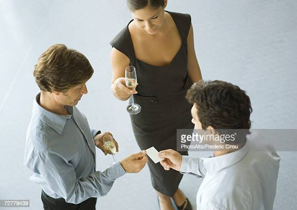 Executives exchanging business card during cocktail party