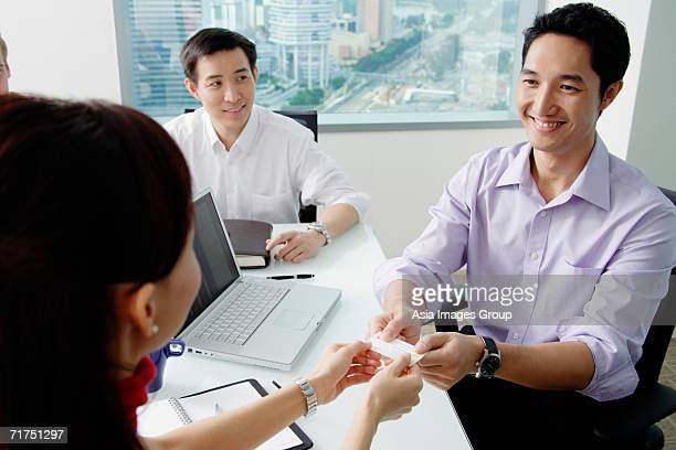 Executives exchanging business card