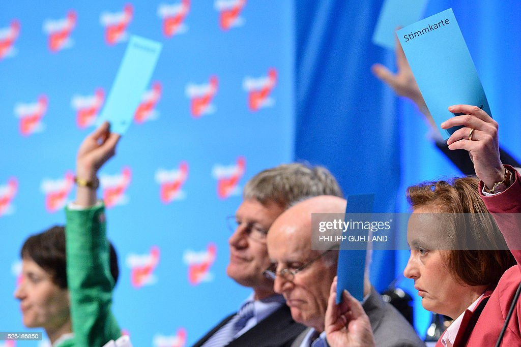 AFD executives Frauke Petry, Joerg Meuthen, Albrecht Glaser and Beatrix von Storch vote during a party congress of the German right wing party AfD (Alternative fuer Deutschland) at the Stuttgart Congress Centre ICS on April 30, 2016 in Stuttgart, southern Germany. The Alternative for Germany (AfD) party is meeting in the western city of Stuttgart, where it is expected to adopt an anti-Islamic manifesto, emboldened by the rise of European anti-migrant groups like Austria's Freedom Party. / AFP / Philipp GUELLAND