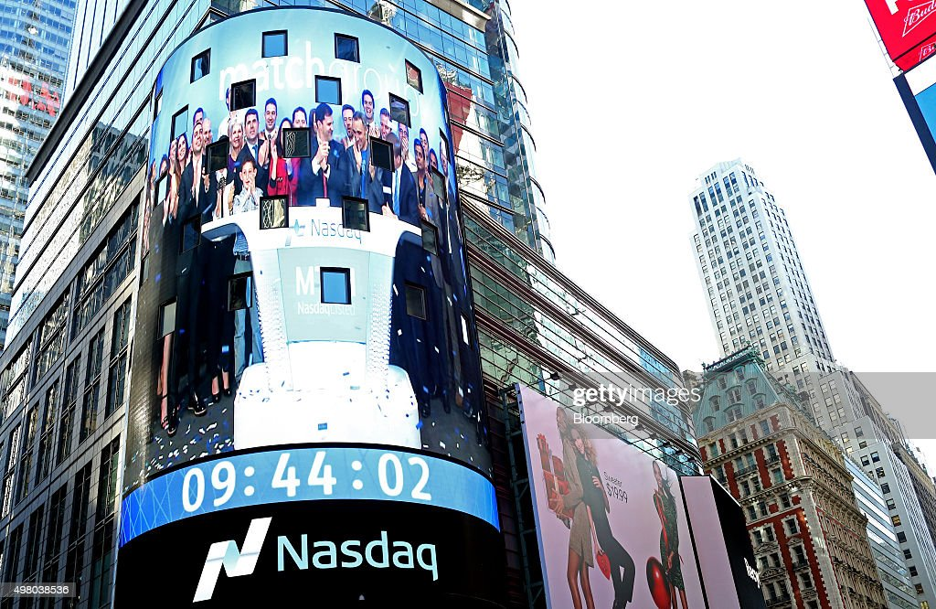 Match Group Executives Ring The Opening Bell At The Nasdaq Photos     Executives from Match Group Inc  appear on a video screen outside the Nasdaq MarketSite as