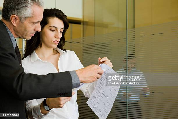 Executives reviewing document together