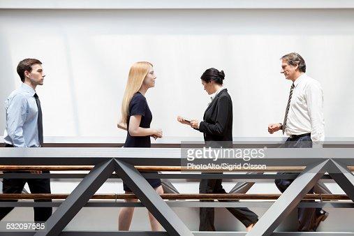 Executives walking in corridor
