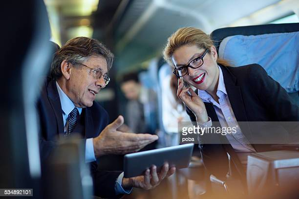 Executives working on train