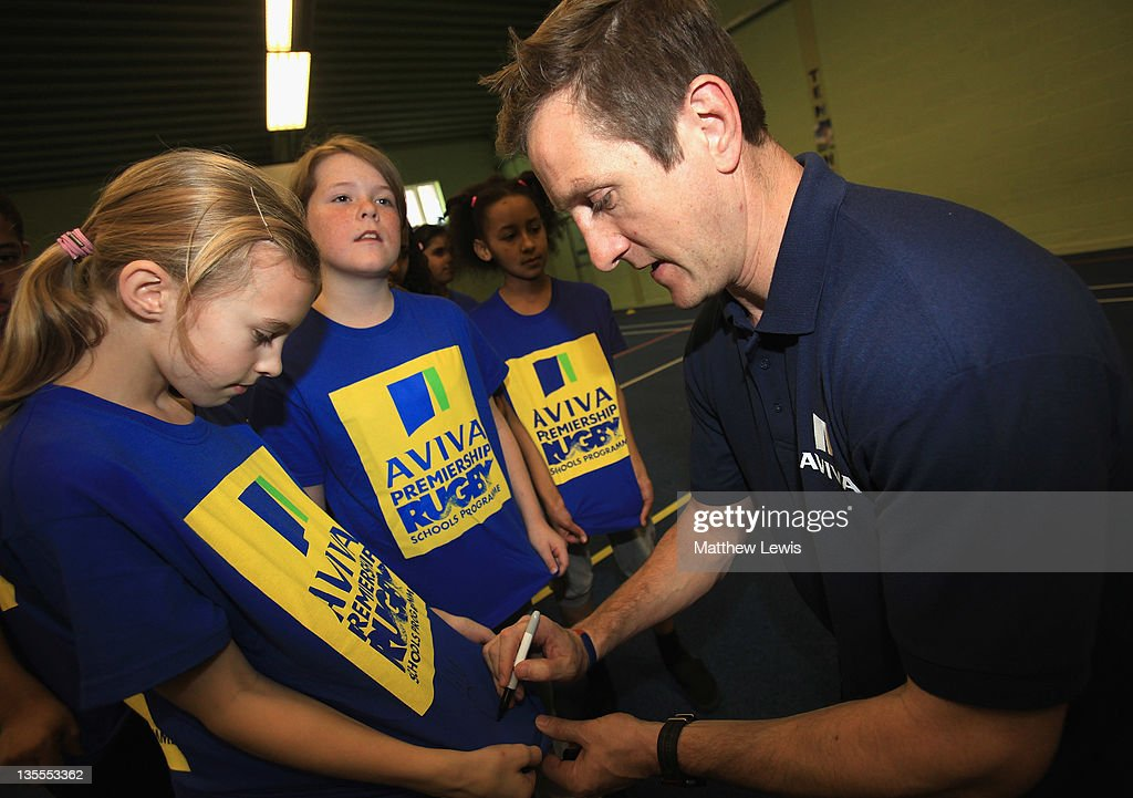 Ex-England and Harlequins rugby player Will Greenwood signs autographs for children from Fosse Primary School during an Aviva Premiership Rugby Schools Programme at Fosse Primary School on December 12, 2011 in Leicester, England.