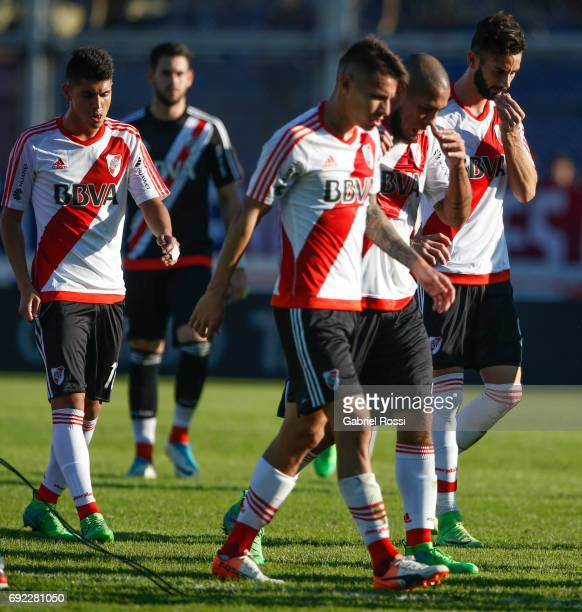 Exequiel Palacios Carlos Auzqui Jonathan Maidana and Marcelo Larrondo of River Plate leave the field after loosing a match between San Lorenzo and...