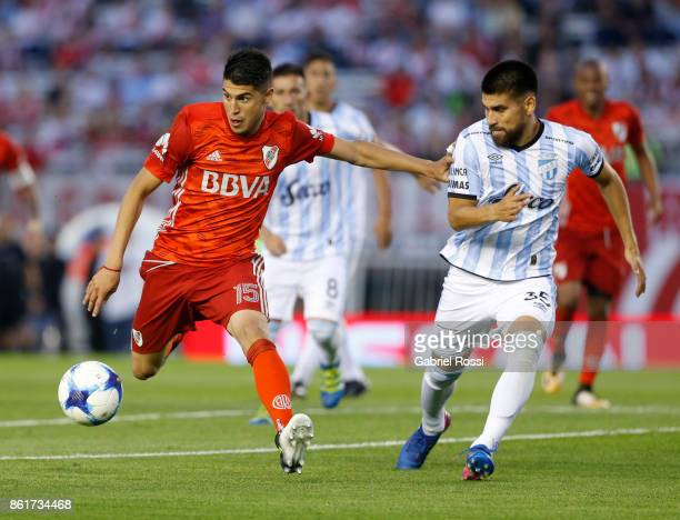 Exequiel Palacios of River Plate fights for the ball with Cristian Villagra of Atletico de Tucuman during a match between River Plate and Atletico de...