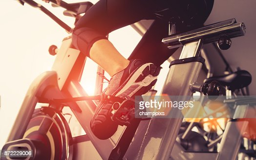Exercise bike cardio workout at fitness gym of woman taking weight loss with machine aerobic for slim and firm healthy in the morning. : Stock Photo