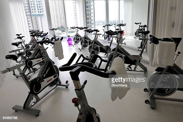 Spinning bikes sit in an exercise room at the Brickell Icon condo development in Miami Florida US on Wednesday Aug 12 2009 The developer of the...