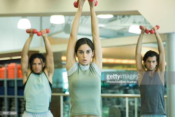 Exercise class working out with dumbbells