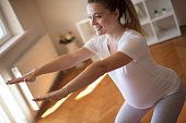 Exercise for future mommies. Pregnant woman working exercise.