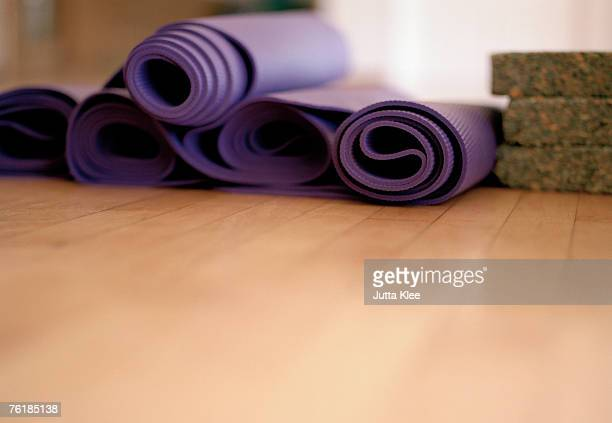 Exercise mats rolled up