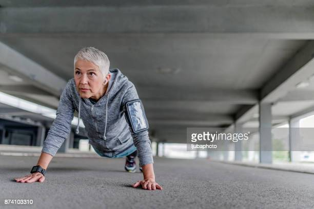Exercise woman doing push-ups outdoors