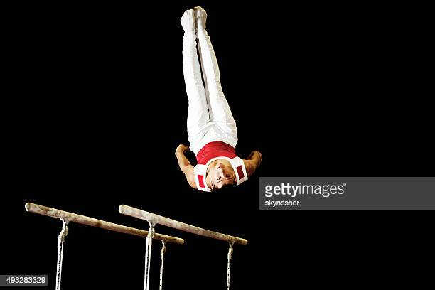 Exercising on parallel bars.