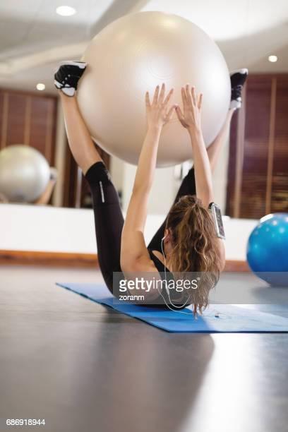 Exercising using fitness ball