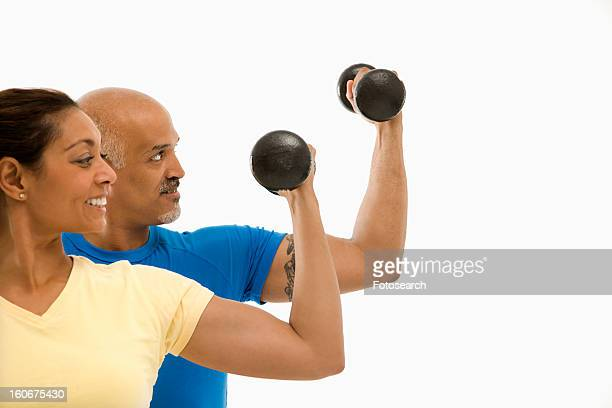 Exercising with dumbbells doing bicep curls