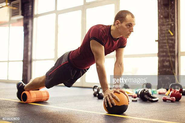 Exercising with foam roller in the gym