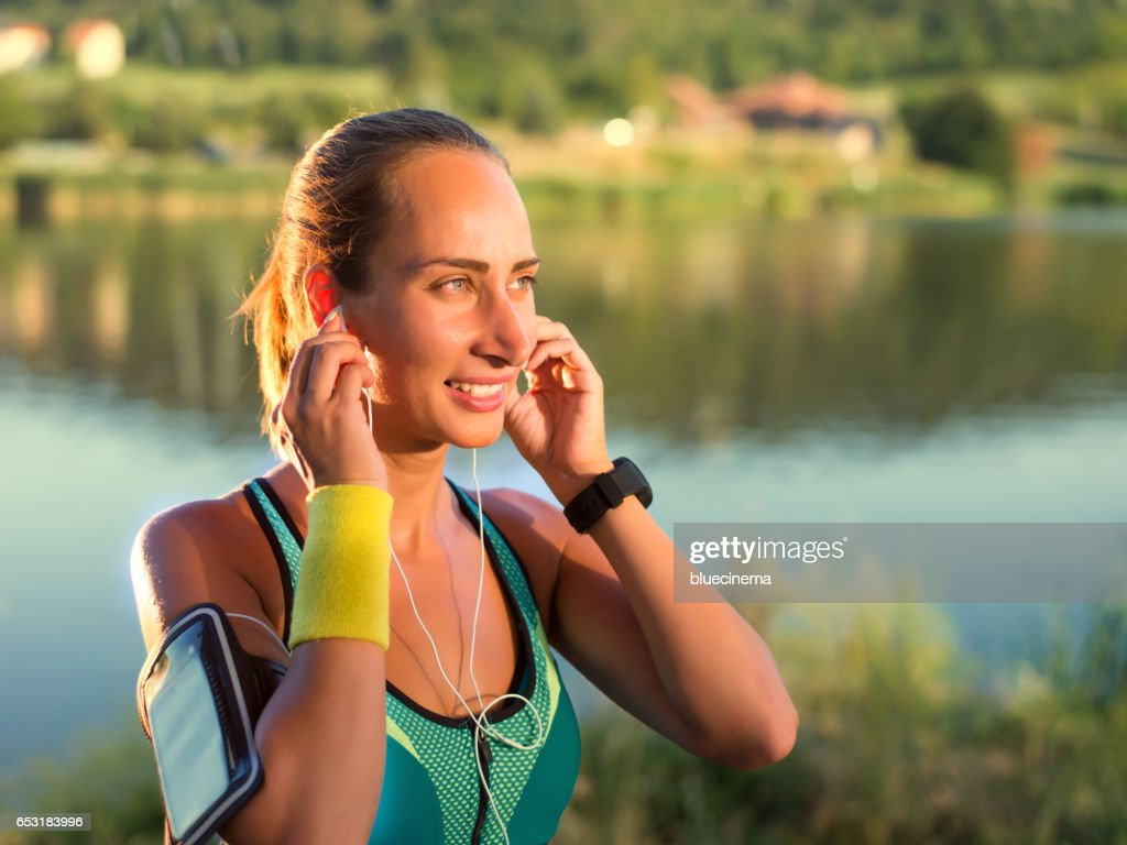 Exercising woman outdoors : Stock Photo
