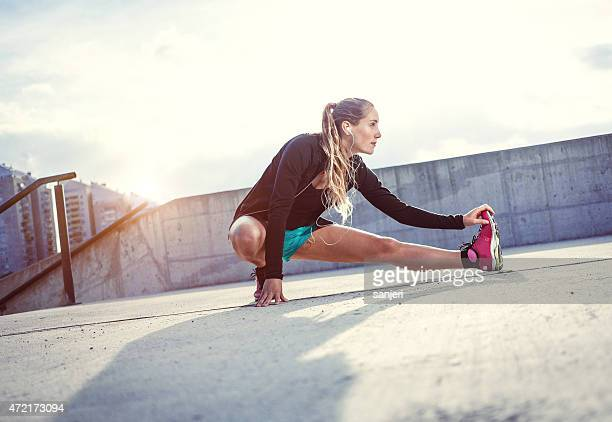 Exercising young woman outdoors