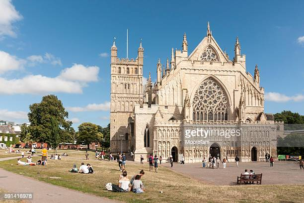 Exeter cathedral green in summer with people relaxing