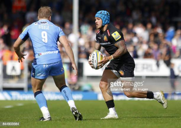 Exeter Chiefs' Jack Nowell goes past past London Irish's Scott Steele during the Aviva Premiership match at Sandy Park Exeter