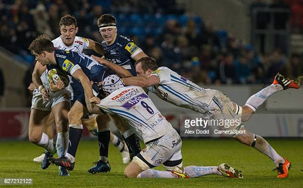 Exeter Chiefs Kai Horstmann and Thomas Waldrom struggle to hang on to Sale Sharks' AJ MacGinty during the Aviva Premiership match between Sale Sharks...