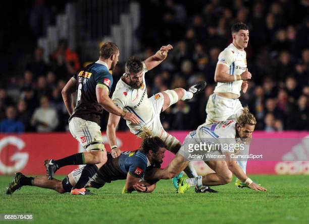 Exeter Chiefs' Michele Campagnaro is tackled by Harlequins' Luke Wallace during the Aviva Premiership match between Harlequins and Exeter Chiefs at...