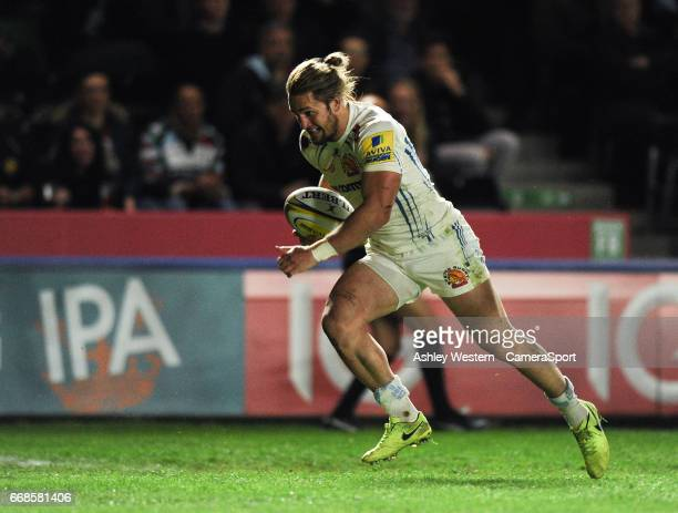 Exeter Chiefs' Michele Campagnaro scores his sides second try during the Aviva Premiership match between Harlequins and Exeter Chiefs at Twickenham...