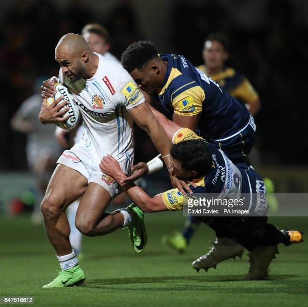 Exeter Chiefs Olly Woodburn beats the tackles of Worcester Warriors Christian ScotlandWilliamson and Jonny Arr to score a try during the Aviva...