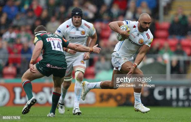 Exeter Chiefs Olly Woodburn gets past Leicester Tigers Nick Malouf during the Aviva Premiership match at Welford Road Leicester