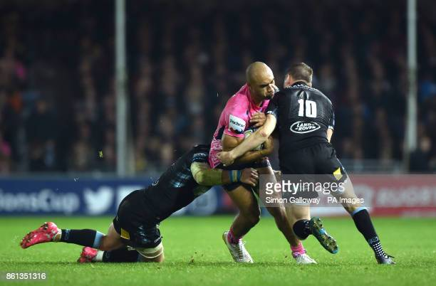 Exeter Chiefs Olly Woodburn is tackled by Glasgow Warriors Finn Russell during the European Champions Cup pool three match at Sandy Park Exeter