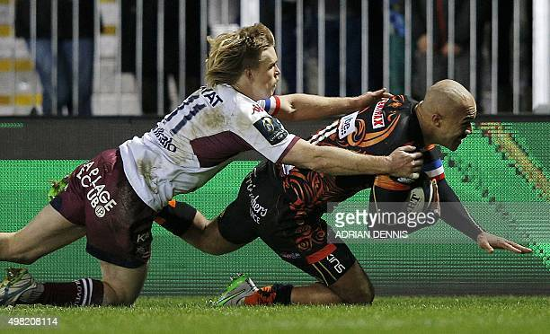 Exeter Chief's wing from England Olly Woodburn scores his team's fourth try during the European Rugby Champions Cup rugby union match between Exeter...
