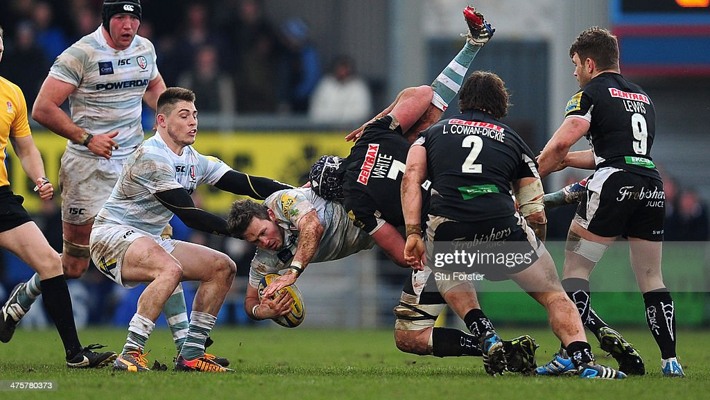 Exeter forward Ben White dumps Irish scrum half Darren Allinson over and is yellow carded during the Aviva Premiership match between Exeter Chiefs...