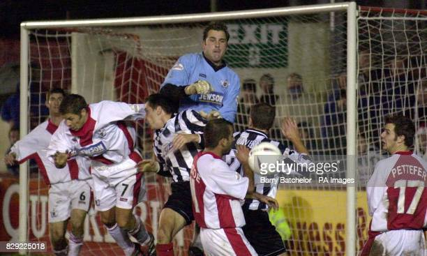 Exeter keeper Kevin Miller gets high to punch away a dangerous ball during the FA Cup 1st Round Replay Exeter City v Forest Green Rovers at Exeter...