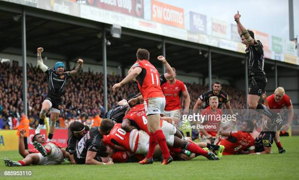 Exeter players celebrate as Sam Simmonds of Exeter Chiefs scores the late match winning try during the Aviva Premiership semi final match between...