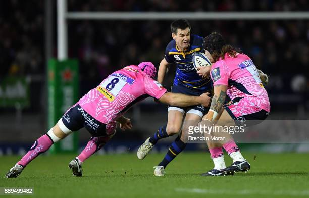 Exeter United Kingdom 10 December 2017 Jonathan Sexton of Leinster in action against Thomas Waldrom left and Harry Williams of Exeter Chiefs during...