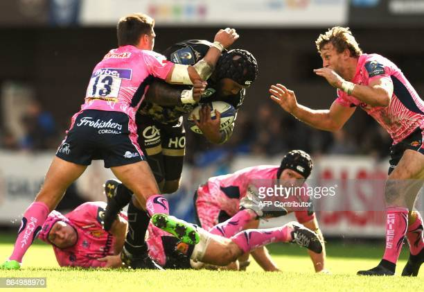 Exeter's flyhalf Henry Slade and Exeter's fullback Lachlan Turner tackle Montpellier's Fijian winger Nemani Nadolo during the European Champions Cup...