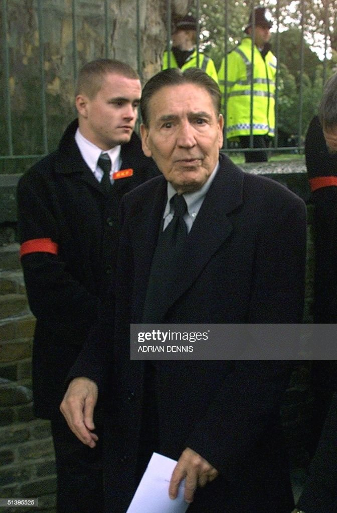 Ex-gangster 'Mad' Frankie Fraser arrives at the funeral service for Reggie Kray at St. Matthew's Church in Bethnal Green in East London Tuesday 11 October 2000. Kray, who died of cancer 10 days ago shortly after being released from prison, was one of Britain's most feared gangsters who held a mafia-like grip on London's East End during the 1960's. Reggie Kray and his twin brother Ronnie were convicted of murder and sentenced to life in 1969.
