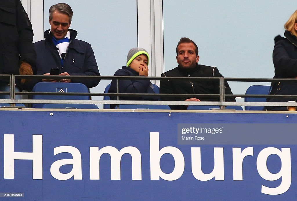 Ex-Hamburg player <a gi-track='captionPersonalityLinkClicked' href=/galleries/search?phrase=Rafael+van+der+Vaart&family=editorial&specificpeople=210815 ng-click='$event.stopPropagation()'>Rafael van der Vaart</a> (R) looks on from the stands prior to the Bundesliga match between Hamburger SV and Borussia Moenchengladbach at Volksparkstadion on February 14, 2016 in Hamburg, Germany.