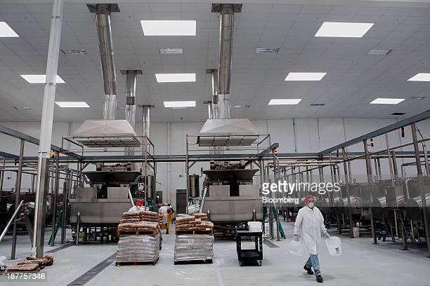 Exhaust ducts are seen as chili peppers are washed and ground up for Sriracha hot sauce at the Huy Fong Foods Inc facility in Irwindale California US...