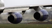 Exhaust emits from the engines of a passenger jet as it prepares for take off at Heathrow Airport on March 30 2006 in London England Air travel is...