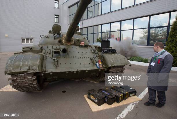 Exhaust fumes escape from a T62 tank as employees demonstrate the use of a supercapacitor to start the engine to members of the media during a news...