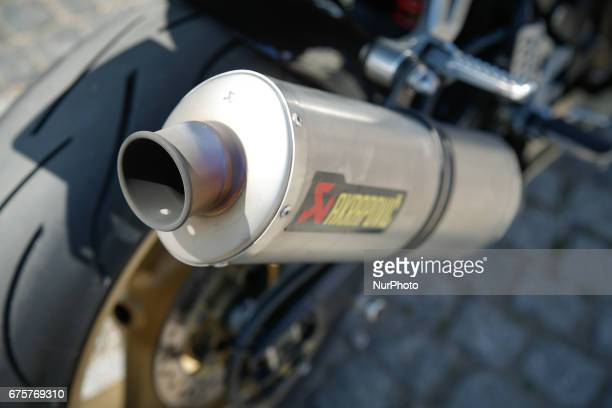 A exhaust pipe from a racing motorcycle is seen during a classic car show in Bydgoszcz Poland on 1 May 2017